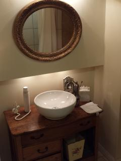 The main floor bathroom vanity. The rain shower behind me is great!