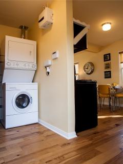 Laundry room is adjacent to kitchen - laundry detergent and dryer sheets provided.