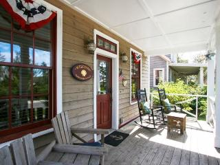 Relax on the spacious front porch in a rocking chair and visit with neighbors