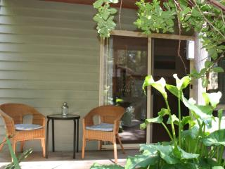 Each cottage has a shaded decking with table and chairs, and an electric bbq