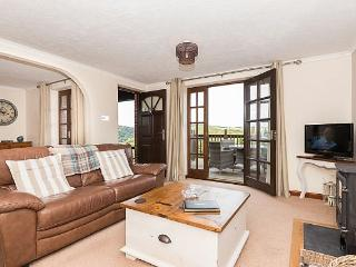 The lounge is beautifully furnished with comfortable leather sofas and has a wood burning stove