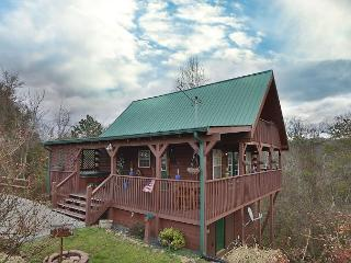 Fireside Memories a 2 bedroom cabin sleeping six. Wrap around wooden deck.