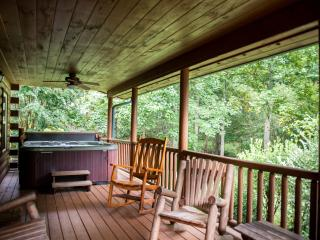 The relaxing covered porch with a hot tub
