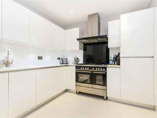 Fully fitted contemporary kitchen with dishwasher and washing machine