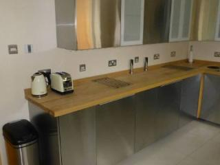 Kitchen with electrically actuated doors, integrated fridge, freezer etc