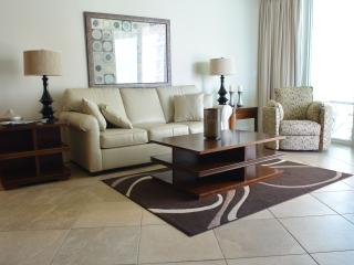 Living Room with Queen Leather Sleeper and Swivel Recliner