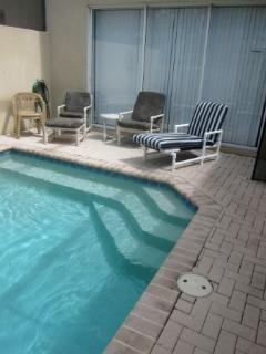 Private splash pool with chaise lounge chair