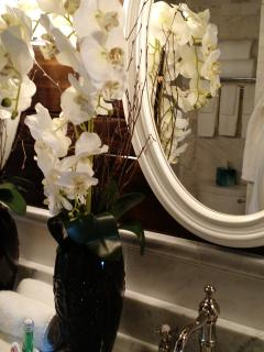 These flowers add an elegant touch to the bathroom.