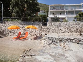 Small beach in front of the villa for our guests