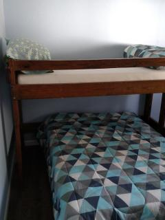 bunk beds (top is twin and bottom is full) a crib is also in this room