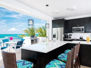 Plum Wild, 2BR beachfront villa on Grace Bay, Turtle Cove