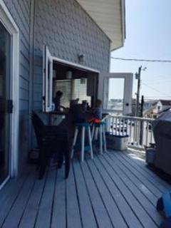 Kitchen Bar  over looking the bay that has a retractable awning