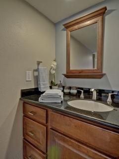 Master bathroom with granite counters, hair dryer, linens & towels provided.