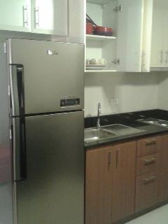 kitchen area with 7ft Refirgerator ( complete kitchen tools)
