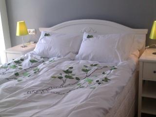 Queen size bed in bedroom.