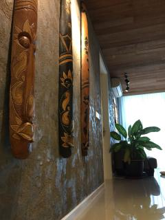 Artistically handcrafted interior walls, raw wood plank ceiling.