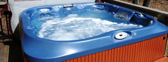 Four person hot-tub.