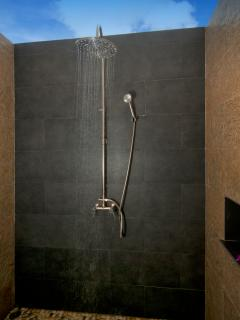 Master bedroom with en-suite bathroom and Bali style outdoor shower.