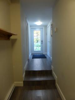 hall way to private entrance at side yard. Door has code lock.