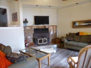 Living room with seating for 6, large TV and fireplace