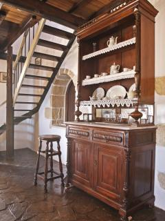 The traditional furniture in the living room.  The stairs to the first floor are in the background.