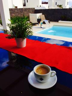 Morning coffee over looking th pool area