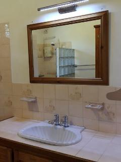 Bathroom with hot and cold shower with large vanity