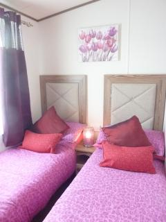Lovely twin beds in the second bedroom