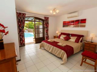 The Master bedroom with super king sized bed,air conditioning and en suite