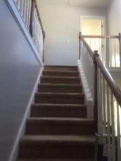 Open stair case to upper bedrooms