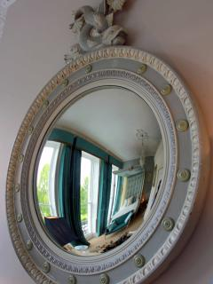 Regency era mirror reflection into master four poster bedroom