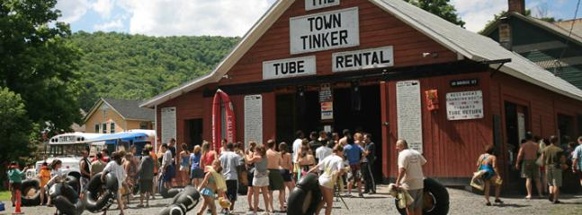 Tubing in town in the summer