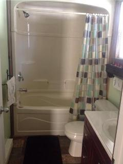 4 pc. bathroom with open linen closet