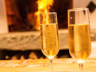 Pop the bubbles and relax in front of the fire, taking in the mountain views