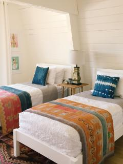 Bedroom 2 has two twin beds and a covered balcony with a peek-a-boo ocean view.