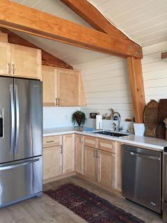 The kitchen is equipped with stainless steel appliances.
