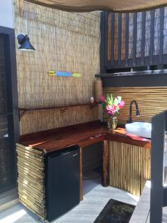 outdoor sink with refrigerator. Built with ohia & koa wood.