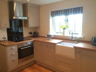 Fully fitted kitchen, including cooker, hob, extractor, fridge/freezer, dishwasher and washer/dryer.
