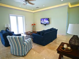 Lounge area with 50' LED TV and cable.  LED lighting behind crown molding.