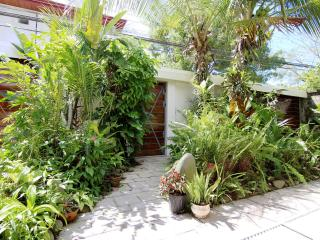 Front entrance to the villa is a tropical courtyard garden behind a secure wall