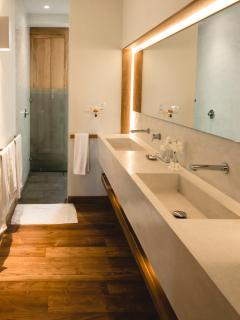 Its ensuite bathroom is spacious and cool.