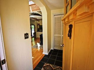 Tiled entry with coat closet.