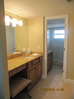 Master dressing area with adjoining shower/toilet area.