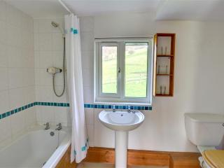 The second smaller bathroom also has a shower over the bath, and lovely views over open fields!
