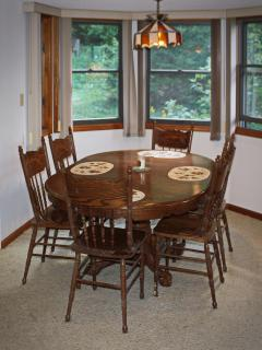Dining area with oak table and chairs