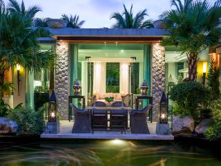 Designer Villa on the Rocks with large swimming pool, Koi pond and waterfall