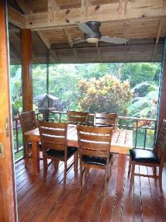 Dining area with screened-in deck just off the great room (inside view)