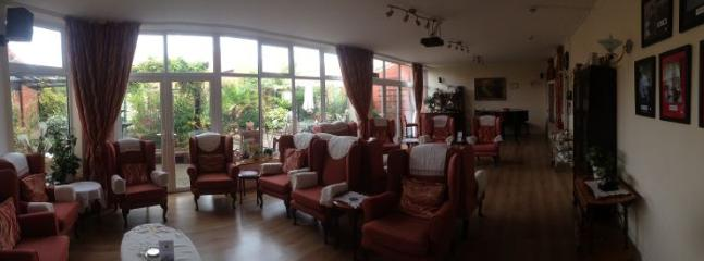 Our large garden lounge overlooks the private landscaped sensory gardens and Koi pond