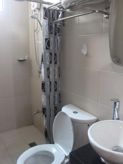 Shower room with water heater and clean towels