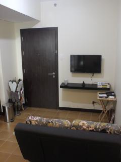 Samsung Smart TV, PLDT landline and my favourite super cozy sofa bed.